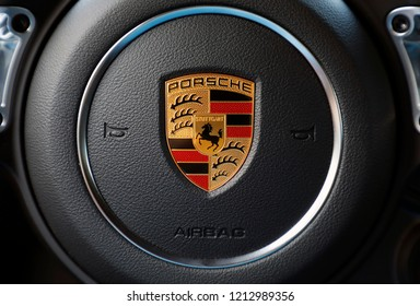 ISTANBUL, OCTOBER 2018: Porsche logo steering close-up of a red car. In 1931, Ferdinand Porsche founded the company with its main offices in central Stuttgart.