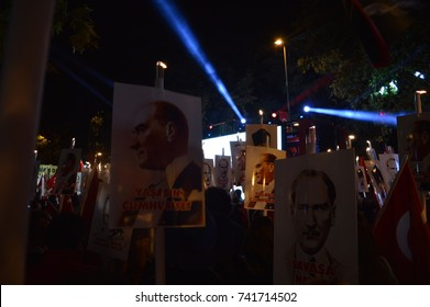 ISTANBUL - October 29, 2015: People are marching with Ataturk posters and Turkish flags during the celebrations of 29 Ekim Cumhuriyet Bayrami, Republic Day of Turkey in Baghdat Street, Kadikoy.