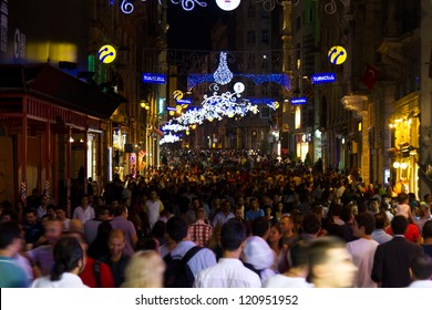 ISTANBUL, SEPTEMBER 01 : People on Istiklal Street at night on September 01, 2012 in Istanbul, Turkey. Istiklal Street is the most popular destination of Istanbul for shopping and entertainment.