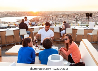 ISTANBUL - SEPTEMBER 12, 2011: Fashionable young people at Nuteras rooftop bar and restaurant overlooking the Bosphorus, Beyoglu