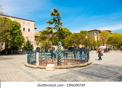 "Istanbul, Sultanahmet / Turkey - 25-04-2019 : Snake column (knitted column) near Blue Mosque (Sultanahmet camii) in the ancient Hippodrome on Istanbul, TURKEY. Serpent Column, ""Three-headed Serpent"
