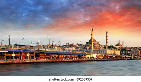 Istanbul at sunset with mosque and bridge