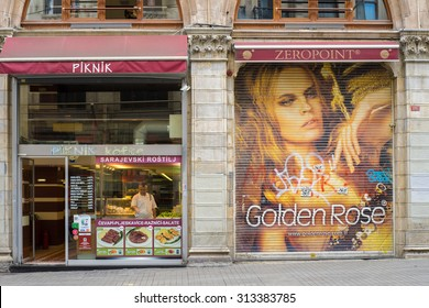 Istanbul, Turkey - 04 Jul 2015: At Istiklal Cd., Istanbul, Turkey, a restaurant selling traditional Turkish food and a cosmetic shop are next to each other. A chef is cooking in the restaurant.