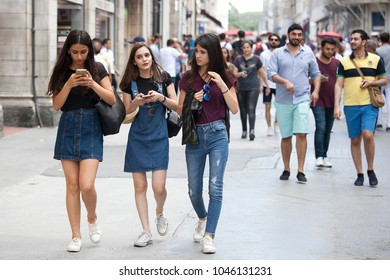 ISTANBUL TURKEY 05 July 2017 People at Istiklal. Girls student in shorts walking down the street