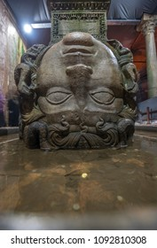Istanbul, Turkey - 05 May 2018: A close up shot of the column with Medusa head base in the Basilica Cistern ( Yerebatan Sarnici ) which lie beneath the city of Istanbul