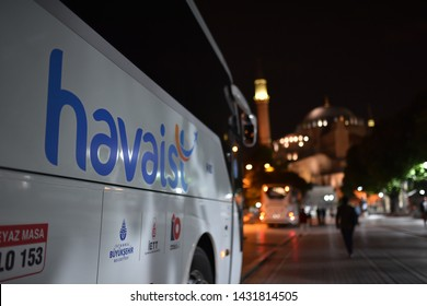 Istanbul / Turkey - 05.14.19: Night transfer bus to airport of havaist service on background Hagia Sophia