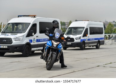 Istanbul / Turkey - 05.15.19: Turkish traffic police (Zabita) on motorcycles. Policeman is take off helmet near police motorbike HONDA VFR1200X on background police vans Ford Transit