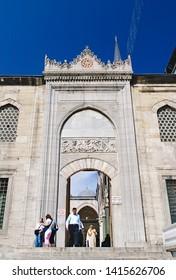 Istanbul, Turkey - 05/24/2010: Eminonu Yeni Cami (new mosque) entrance, Istanbul, Turkey.People outside of Eminonu Yeni Cami (new mosque) entrance, Istanbul, Turkey.
