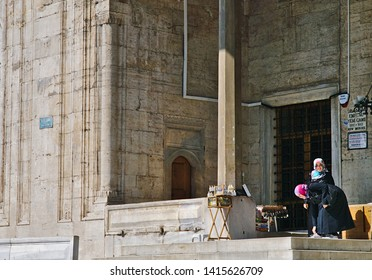 Istanbul, Turkey - 05/24/2010: Two smiling muslim young women, outside of Eminonu Yeni Cami mosque