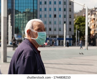 Istanbul / Turkey - 05/29/2020: masked an old man on the street
