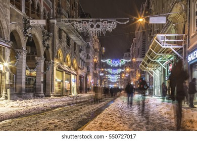 Istanbul, Turkey - 07 January 2017: People silhouettes walking in the streets of Istiklal while snowing