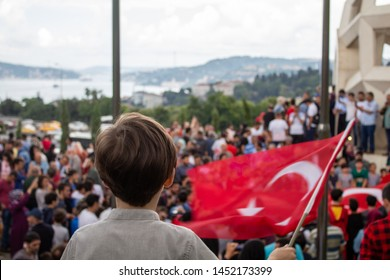 Istanbul / Turkey 07.15.2019 July 15 coup attempt anniversary. Children waving flag at the monument on July 15