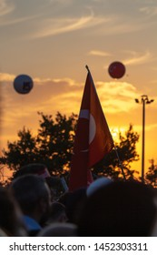 Istanbul / Turkey 07.15.2019 July 15 coup attempt anniversary. Crowd people going to meeting area. Perfect Turkish flag against the sunset.