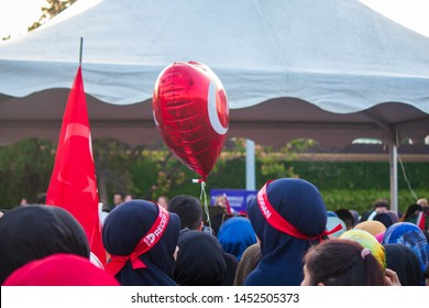 Istanbul / Turkey 07.15.2019 July 15 coup attempt anniversary. Recep Tayyip Erdogan Bandanas and Turkish Flagged Balloon