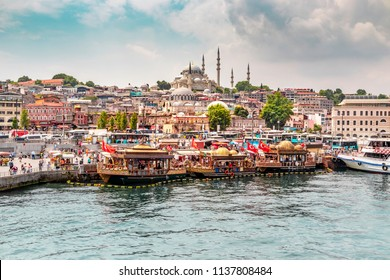Istanbul / Turkey - 07.18.2018: View of Istanbul Old City from Galata Bridge. Colourful midday business of Istanbul.