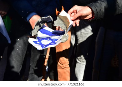 Istanbul, Turkey, 08 December 2017: Protestors burn Israeli flag and shout slogans against US President Donald Trump during a protest against the Israel and US at Fatih Mosque after Friday prayer