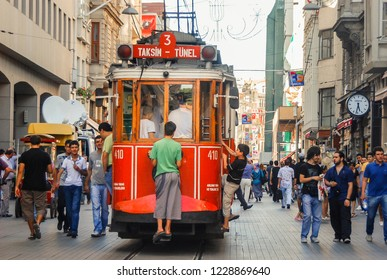 Istanbul - Turkey - 08-08-2011: A historic rd tram in the crowded Istiklal street in the Beyoglu district of Istanbul.