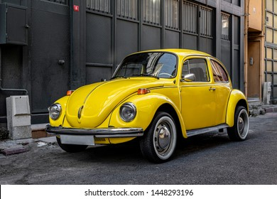 istanbul- turkey 08.july. 2019. parked in the street, yellow volkswagen beetle