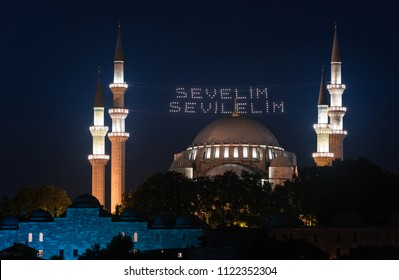 "ISTANBUL, TURKEY - 10 JUNE: ""Let's Love Love"" lettering hanging on Suleymaniye Mosque mahya in Istanbul Turkey on 10 june 2018. Ridge is an Ottoman tradition has been applied since 1616."