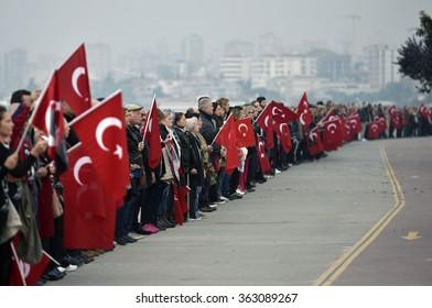 Istanbul, Turkey - 10 November 2015: Turkish people wait a minute's silence at anniversary dead of Mustafa Kemal Ataturk