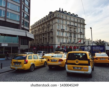 Istanbul / Turkey - 12/03/2018: Traffic jam involving taxi cars in popular touristic district Beyoglu with a view at Pera Palace hotel