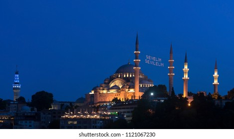 "ISTANBUL, TURKEY - 13 JUNE: ""Let's Love Love"" lettering hanging on Suleymaniye Mosque mahya in Istanbul Turkey on 13 june 2018. Ridge is an Ottoman tradition has been applied since 1616."