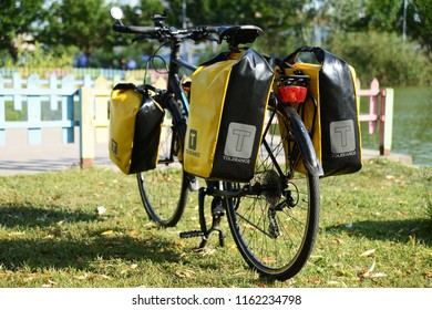 ISTANBUL, TURKEY - 19 August 2018 Loaded touring bicycle parking on the nature front of lake with yellow panniers at sunny day