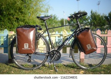 ISTANBUL, TURKEY - 19 August 2018 Loaded touring bicycle parking on the nature front of lake with brown panniers at sunny day
