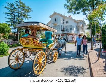 Istanbul, Turkey, 20 August 2018: Buyukada Island street view. Coach and Horses at Buyukada, Princes Islands district of Istanbul