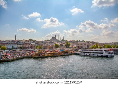 Istanbul, Turkey, 20 August 2018: Beautiful View touristic landmarks from sea voyage on Bosphorus. Cityscape of Istanbul at sunset - old mosque and turkish steamboats, view on Golden Horn.