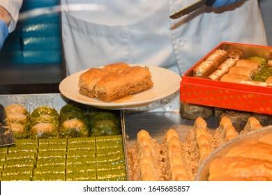 Istanbul, Turkey, 20.12.2019: Hafiz Mustafa shop in Istanbul, traditional turkish desserts like baklava, turkish delight, cream brulee, rice puddings, cakes, teas, kunefe, knafeh desserts