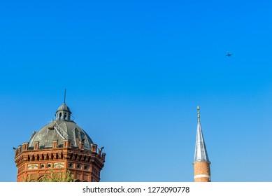 Istanbul, Turkey, 21 April 2006: Kizil Church and Darulmesnevi Mosque Minaret at Balat, Halic