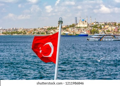 Istanbul, Turkey, 21 August 2018: View of the Turkish Flag and Galata Tower, Galata Bridge, Karakoy district and Golden Horn