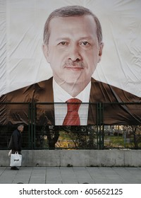 ISTANBUL, TURKEY, 21 MARCH 2017 A man walking in front of a huge Turkish President Recep Tayyip Erdogan's picture in Istanbul.
