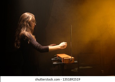 istanbul Turkey,  23 th march 2019 , The theremin is an electronic musical instrument controlled without physical contact by the thereminist , girl playing theremin