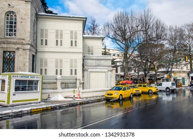 Istanbul, Turkey, 26 January 2010: Hamid-i Evvel Mosque and yellow taxi, Cinaralti, Emirgan