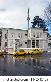 Istanbul, Turkey, 26 January 2010: White wooden Mansion and yellow taxi, Cinaralti, Emirgan