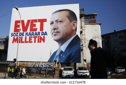 ISTANBUL, TURKEY, 30 MARCH 2017 A man walking in front of huge Turkish President Recep Tayyip Erdogan's picture in Istanbul.