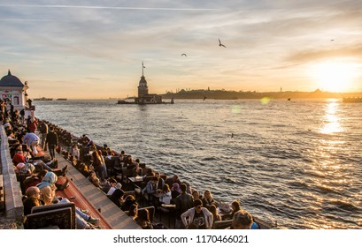 Istanbul, Turkey - 6th march 2016: people watching the sunset