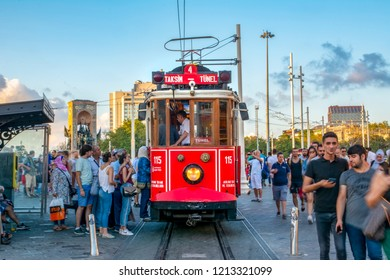 ISTANBUL, TURKEY – Agust  11, 2018: Nostalgic Red Tram in Taksim Istiklal Street at evening. Taksim Istiklal Street is a popular destination in Istanbul. Beyoglu, Taksim, Istanbul. Turkey.