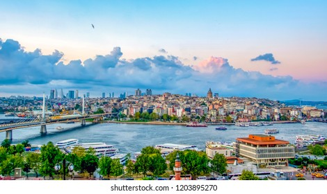 ISTANBUL, TURKEY – AGUST 12, 2018:   View touristic landmarks from sea voyage on Bosphorus. Cityscape of Istanbul at sunset - old mosque and turkish steamboats, view on Golden Horn