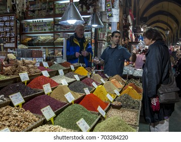 ISTANBUL, TURKEY - APRIL 01, 2010 : A tourist smells the aroma of a spice at a stall in the Spice Bazaar in the Eminonu district of Istanbul of Turkey.