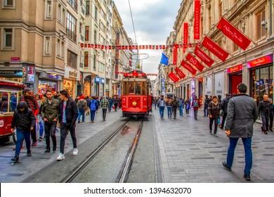 Istanbul, Turkey April 03, 2019: Nostalgic Red Tram in Taksim Istiklal Street at evening. Taksim Istiklal Street is a popular destination in Istanbul. Beyoglu, Taksim, Istanbul. Turkey.