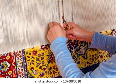 Istanbul Turkey – April 09, 2019: The woman weaving traditional carpet from Istanbul with colorful wool.ıstanbul Turkey