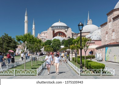 ISTANBUL, TURKEY, APRIL 1, 2019: People walking at Sultanahmet Square, Hagia Sophia can be seen at the background. Sultanahmet District is the heart of old Istanbul.