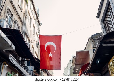 Istanbul, Turkey - April 13, 2018: Turkish flag weighs in between houses in Fatih district on April 13, 2018 in Istanbul, Turkey.