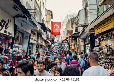 Istanbul, Turkey - April 13, 2018: Turkish flag weighs in between houses and crowds of people in Fatih district on April 13, 2018 in Istanbul, Turkey.