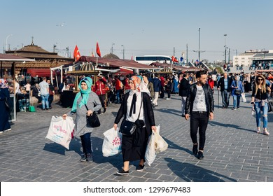 Istanbul, Turkey - April 13, 2018: People on square in Eminonu district  on April 13, 2018 in Istanbul, Turkey.