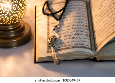 Istanbul , Turkey -April 14, 2018; Koran - holy book of Muslims with lantern and rosary .ramadan concept.
