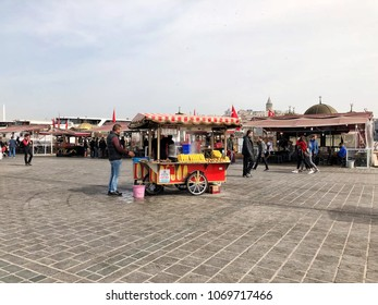 Istanbul, Turkey - April 16: People and vendors on Eminonu square is a popular place in Istanbul, Turkey.